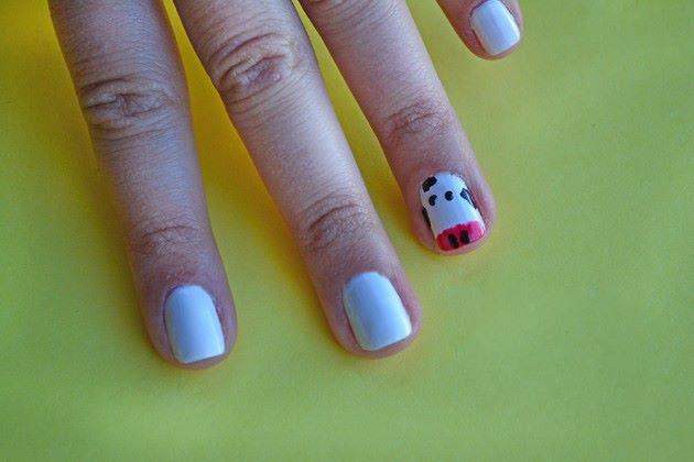Aprenda como decorar suas unhas com vaquinhas